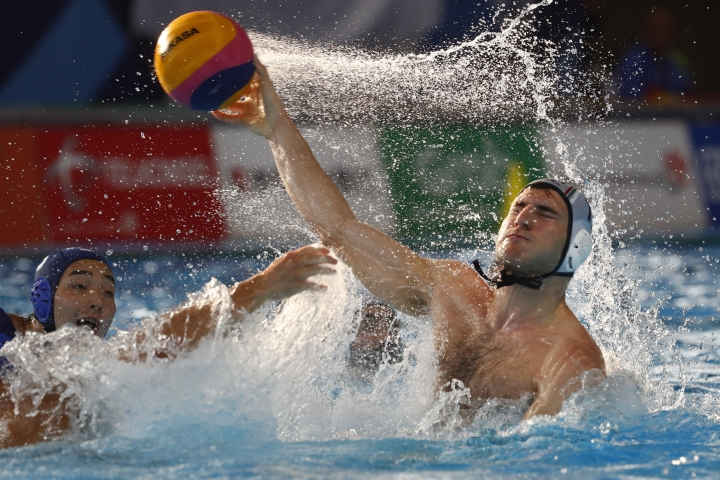 Iran's Arshia Almasi takes a shoot during the water polo semifinal against Japan at 18th Asian Games in Jakarta, Indonesia, Friday, Aug. 31, 2018. (AP Photo/Bernat Armangue)