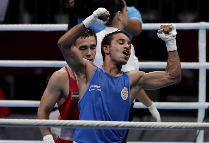 India's Amit reacts after defeating Uzbekistan's Dusmatov Hasanboy in their men's light flyweight boxing final at the 18th Asian Games in Jakarta, Indonesia, Saturday, Sept. 1, 2018. (AP Photo/Lee Jin-man)
