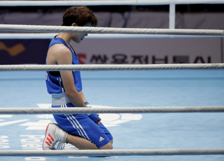 South Korea's Oh Yeonji reacts after defeating Thailand's Sudaporn Seesondee in their women's lightweight boxing final at the 18th Asian Games in Jakarta, Indonesia, Saturday, Sept. 1, 2018. (AP Photo/Lee Jin-man)