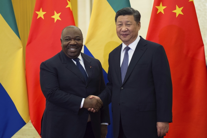Gabon's President Ali Bongo Ondimba, left, shake hands with China's President Xi Jinping, prior to their bilateral meeting at the Great Hall of the People, in Beijing, China, Saturday, Sept. 1, 2018 ahead of the Forum on China-Africa Cooperation which will be held Sept. 3-4. (Nicolas Asfouri/Pool Photo via AP)