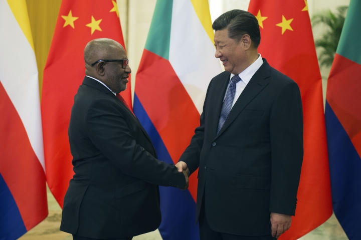 Comoros' President Azali Assoumani, left, shake hands with China's President Xi Jinping, prior to their bilateral meeting at the Great Hall of the People, in Beijing, China, Saturday, Sept. 1, 2018 ahead of the Forum on China-Africa Cooperation which will be held Sept. 3-4. (Nicolas Asfouri/Pool Photo via AP)