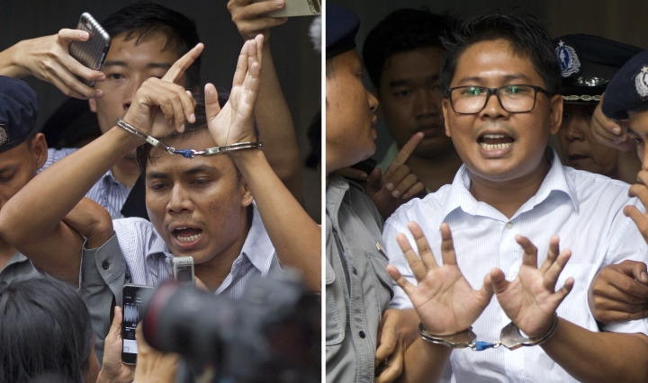 In this combination image made from two photos, Reuters journalists Kyaw Soe Oo, left, and Wa Lone, are handcuffed as they are escorted by police out of the court Monday, Sept. 3, 2018, in Yangon, Myanmar. The court sentenced the two journalists to seven years in prison Monday for illegal possession of official documents, a ruling that comes as international criticism mounts over the military's alleged human rights abuses against Rohingya Muslims. (AP Photo/Thein Zaw)
