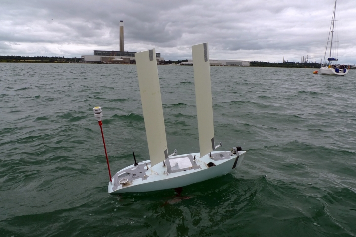 In this photo taken on Monday, Aug. 27, 2018, A robotic boat operated by a team from China's Shanghai Jiaotong University undergoes testing at the World Robot Sailing Championship in Southampton, England. The contest and a related competition, a trans-Atlantic race known as the Microtransat Challenge, are aimed at stimulating development of autonomous sailboat technology. (AP Photo/Kelvin Chan)