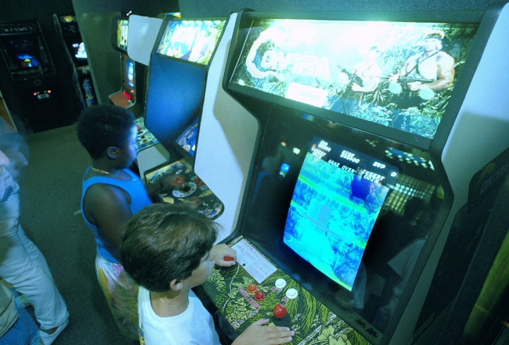 """FILE- In this July 21, 1987, file photo, Carlos Tunnerman, 10, plays the """"Contra"""" video game at an arcade in a Miami, Fla. Decades of study have failed to validate the most prevalent fear, that violent games encourage violent behavior. But from the moment the games emerged as a cultural force in the early 1980s, parents fretted about the way kids could lose themselves in games as simple and repetitive as """"Pac-Man,"""" """"Asteroids"""" and """"Space Invaders."""" (AP Photo/Joe Skipper, File)"""