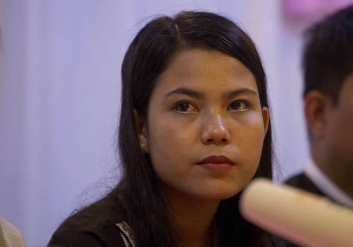 Chit Su Win, wife of Reuters journalist Kyaw Soe Oo, listens to questions during a press briefing at a hotel Tuesday, Sept. 4, 2018, in Yangon, Myanmar. A Myanmar court sentenced two Reuters journalists to seven years in prison Monday on charges of illegal possession of official documents, a ruling met with international condemnation that will add to outrage over the military's human rights abuses against Rohingya Muslims. (AP Photo/Thein Zaw)