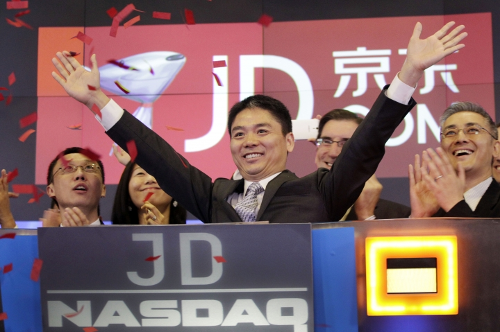 FILE - In this file photo taken Thursday, May 22, 2014, Liu Qiangdong, also known as Richard Liu, CEO of JD.com, raises his arms to celebrate the IPO for his company at the Nasdaq MarketSite, in New York. JD.com, China's No. 2 e-commerce service, is headquartered in Beijing. The Chinese e-commerce billionaire who faces a possible rape accusation in Minneapolis built his business by promising honesty in a market plagued by fraud and fakes. (AP Photo/Mark Lennihan, File)
