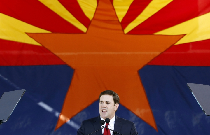 FILE - In this Jan. 5, 2015, file photo, Republican Arizona Gov. Doug Ducey addresses the crowd after being sworn in during inauguration ceremonies at the Arizona Capitol in Phoenix. Arizona has developed a reputation over the past decade for being one of the country's greatest political flashpoints, with divisive debates over immigration, rambunctious populists and a divided GOP. Ducey has navigated the state's political waters with a buttoned-down approach. The onetime chief executive officer of ice cream chain Cold Stone Creamery on Tuesday, Sept. 4, 2018, named former Sen. Jon Kyl to fill the seat vacated by the late John McCain.(AP Photo/Ross D. Franklin, File)