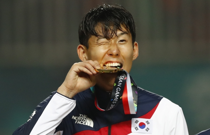 South Korea's Son Heung-min celebrates on the podium after defeating Japan in the men's soccer gold medal match at the 18th Asian Games in Bogor, Indonesia, Saturday, Sept. 1, 2018. (AP Photo/Bernat Armangue)