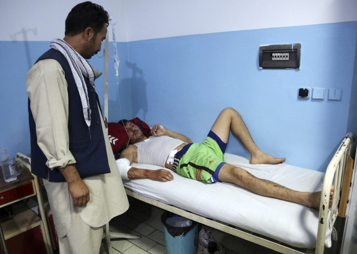 An injured man receives treatment at a hospital following a deadly attack in Kabul, Afghanistan, Wednesday, Sept. 5, 2018. Twin bombings at a wrestling training center in a Shiite neighborhood of Afghanistan's capital on Wednesday killed at least 20 people and wounded others, Afghan officials said. (AP Photo/Rahmat Gul)