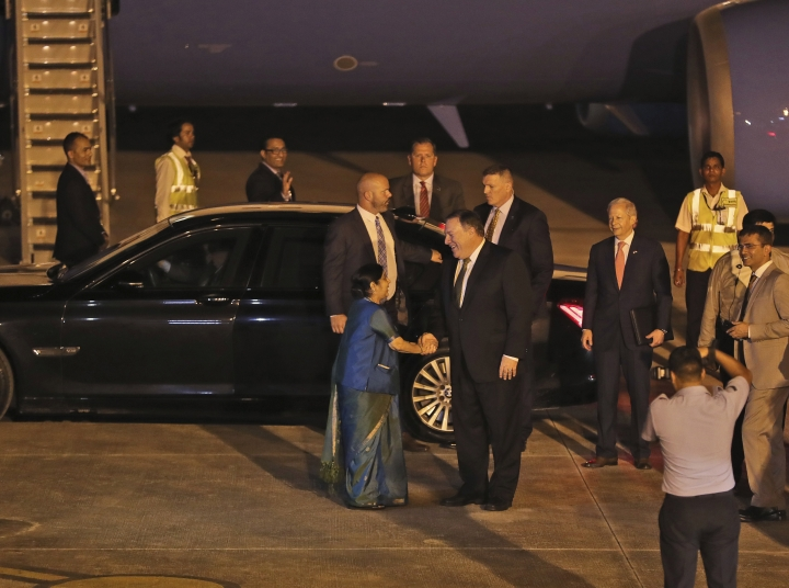 U.S. Secretary of State Mike Pompeo, right, is greeted by Indian External Affairs Minister Sushma Swaraj upon arrival at the airport in New Delhi, India, Wednesday, Sept. 5, 2018. (AP Photo/Manish Swarup)