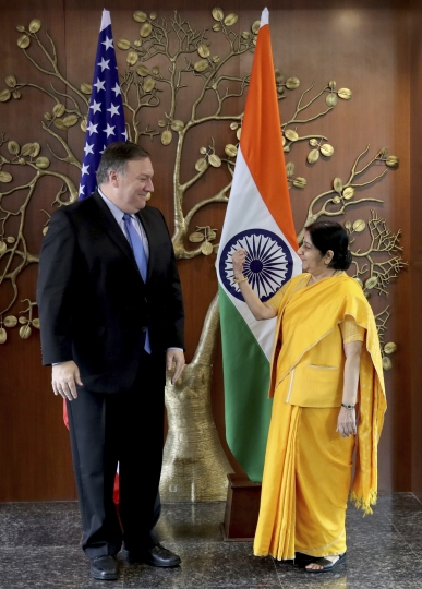 U.S. Secretary of State Mike Pompeo, left, speaks with Indian Foreign Minister Sushma Swaraj before a meeting in New Delhi, India, Thursday, Sept. 6, 2018. Pompeo and Defense Secretary James Mattis are holding long-delayed talks Thursday with top Indian officials, looking to shore up the alliance with one of Washington's top regional allies. (AP Photo/Manish Swarup)
