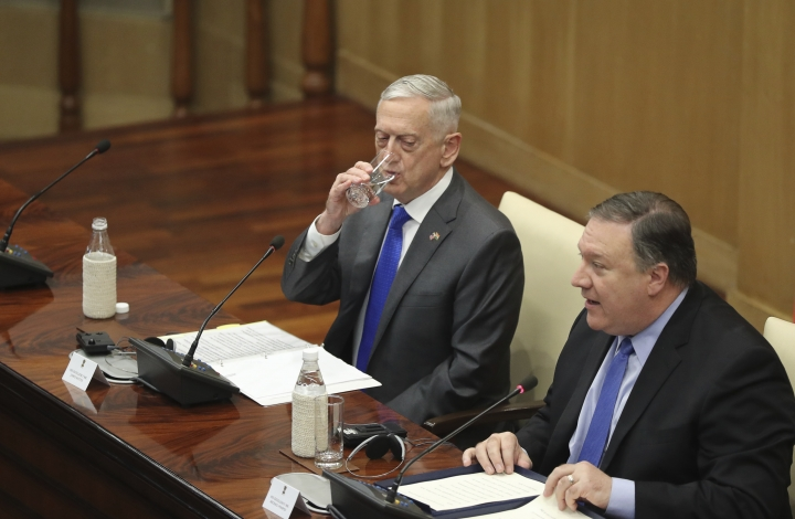 "U.S. Defense Secretary James Mattis, left, drinks water as U.S. Secretary of State Mike Pompeo, makes his statement after the so called ""2+2"" meeting in New Delhi, India, Thursday, Sept. 6, 2018. Pompeo and Mattis held long-delayed talks Thursday with top Indian officials, looking to shore up the alliance with one of Washington's top regional partners. (AP Photo/Manish Swarup)"