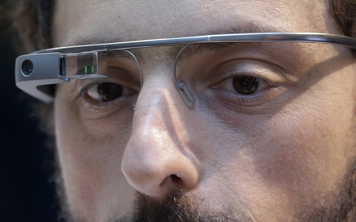 FILE - In this Feb. 20 2013, file photo, Google co-founder Sergey Brin wears a Google Glass device in San Francisco. Twenty years after Larry Page and Brin set out to organize all of the internet's information, the search engine they named Google has morphed into a dominating force in smartphones, online video, email, maps and much more. (AP Photo/Jeff Chiu, File)
