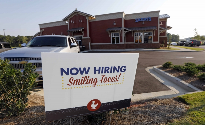 This July 25, 2018, photo shows a help wanted sign at a new Zaxby's restaurant in Madison, Miss. On Friday, Sept. 7, the Labor Department reports on job openings and labor turnover for August. (AP Photo/Rogelio V. Solis)