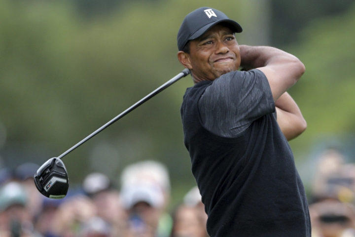 Tiger Woods tees off at the 10th hole during the third round of the BMW Championship golf tournament at Aronimink in Newtown Square, Pa., Saturday, Sept. 8, 2018. (Charles Fox/The Philadelphia Inquirer via AP)