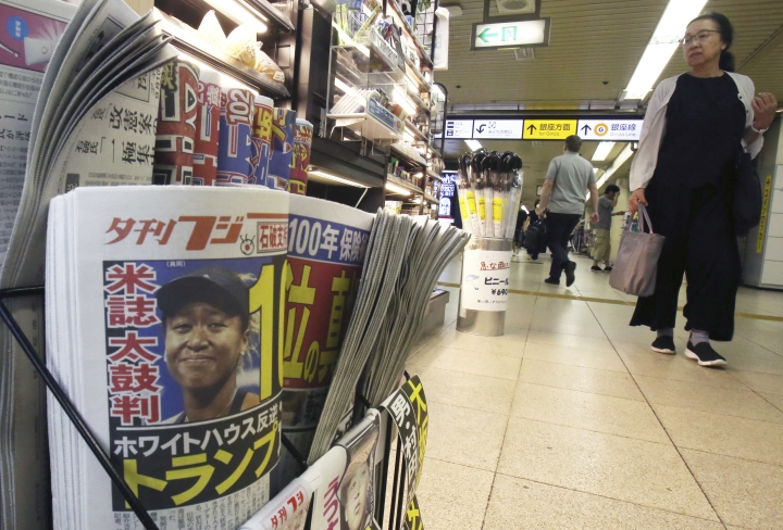 Sports and tabloid newspapers reporting Naomi Osaka's victory in the U.S. Open tennis finals are sold at a newsstand in Tokyo, Monday, Sept. 10, 2018. Osaka defeated Serena Williams of the U.S. 6-2, 6-4 on Saturday night to become the first Grand Slam singles champion from Japan. (AP Photo/Koji Sasahara)