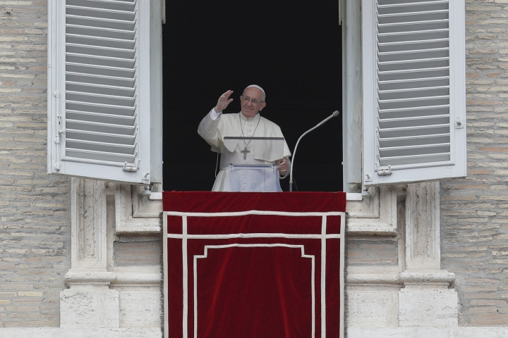 Pope Francis delivers a blessing as he recites the Angelus noon prayer from his studio's window overlooking St. Peter's Square at the Vatican, Sunday, Sept. 9, 2018. (AP Photo/Gregorio Borgia)