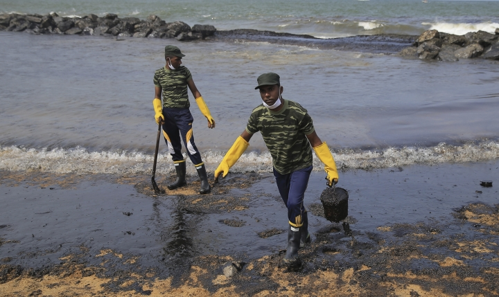 Sri Lankan army soldiers work to remove oil from a beach following an oil spill in Uswetakeiyawa, a coastal town north of Colombo, Sri Lanka, Monday, Sept. 10, 2019.Sri Lanka deployed hundreds of coast guard and navy personnel on Monday to clean oil slicks on a coastal stretch near the capital following a spill caused by a pipeline leak. (AP Photo/Eranga Jayawardena)
