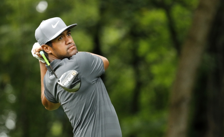 FILE - In this Tuesday, Aug. 7, 2018 file photo, Tony Finau hits on the 17th tee during a practice round for the PGA Championship golf tournament at Bellerive Country Club in St. Louis. ony Finau has been named to the Ryder Cup team, the final pick by U.S. captain Jim Furyk. Finau joins Bryson DeChambeau, Phil Mickelson and Tiger Woods as Furyk's four wild-card selections. Finau has 11 top-10s this season, including three in majors. (AP Photo/Charlie Riedel, File)