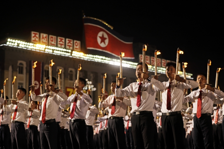 North Korean youths holding torches march during a torch light march at the Kim Il Sung Square in conjunction with the 70th anniversary of North Korea's founding day in Pyongyang, North Korea, Monday, Sept. 10, 2018. Tens of thousands of North Koreans rallied in the square in the final major event of the country's 70th anniversary, an elaborate celebration that was focused on Korean unity and economic development and that deliberately downplayed the missiles and nuclear weapons that brought the North to the brink of conflict with the United States just one year ago. (AP Photo/Kin Cheung)