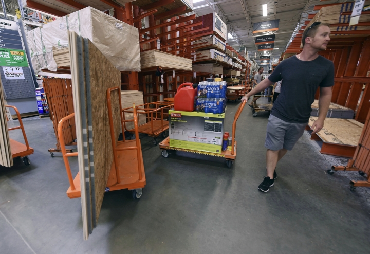 Alex Gilewicz buys supplies at The Home Depot on Monday, Sept. 10, 2018, in Wilmington, N.C. Residents of Wilmington and Southeastern N.C. Florence rapidly strengthened into a potentially catastrophic hurricane on Monday as it closed in on North and South Carolina, carrying winds and water that could wreak havoc over a wide stretch of the eastern United States later this week. (Ken Blevins/The Star-News via AP)