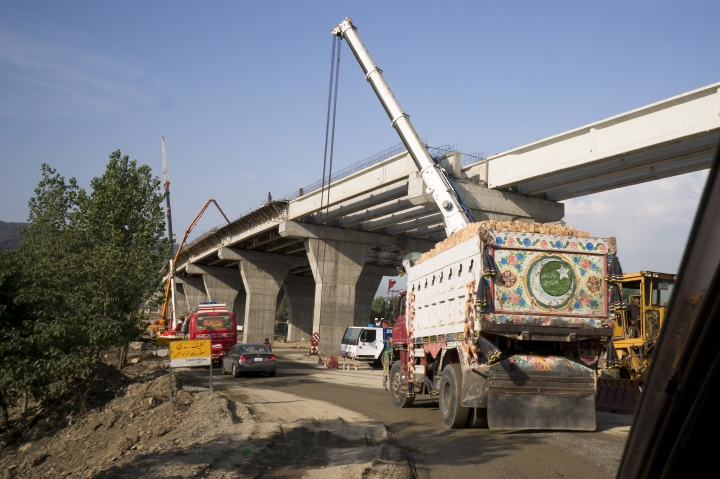 """FILE - This May 11, 2017, file photo shows construction work in progress at a new international trade route which part of a sprawling Chinese initiative to build a """"new Silk Road"""" of ports, railways and roads to expand trade in a vast arc of countries across Asia, Africa and Europe, near Havalian in Pakistan. A wave of Chinese-financed railways and other trade links in Africa and Asia that have prompted worries about debt and Beijing's ambitions is reducing politically dangerous inequality between regions within countries, a multinational group of researchers said Tuesday, Sept. 11, 2018. (AP Photo/B.K. Bangash, File)"""