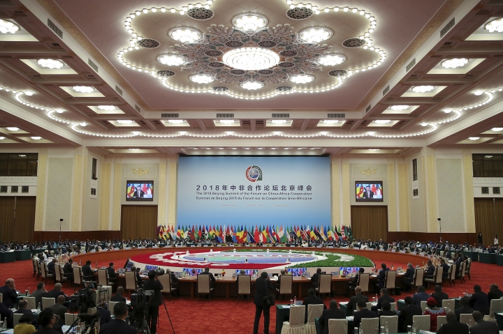 FILE - In this Sept. 4, 2018, file photo, Chinese President Xi Jinping speaks as he chairs the 2018 Beijing Summit Of The Forum On China-Africa Cooperation - Round Table Conference at the Great Hall of the People in Beijing. A wave of Chinese-financed railways and other trade links in Africa and Asia that have prompted worries about debt and Beijing's ambitions is reducing politically dangerous inequality between regions within countries, a multinational group of researchers said Tuesday, Sept. 11, 2018. (Lintao Zhang/Pool photo via AP, File)