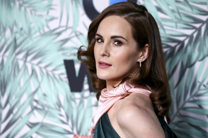 """FILE - In this Feb. 24, 2017, file photo, Michelle Dockery arrives at the 10th Annual Women in Film Pre-Oscar Cocktail Party at Nightingale Plaza in Los Angeles. Filming has begun for the """"Downtown Abbey"""" movie. Dockery, who plays Lady Mary in the global hit, posted a photo on Instagram with the caption, """"And...we're off."""" (Photo by Rich Fury/Invision/AP, File)"""