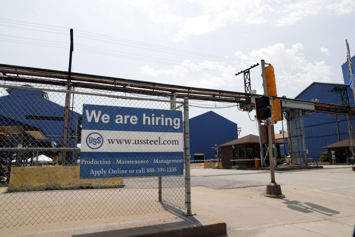 FILE- In this June 28, 2018, file photo, a help wanted sign hangs outside the U.S. Steel Granite City Works facility in Granite City, Ill. On Tuesday, Sept. 11, the Labor Department reports on job openings and labor turnover for July. (AP Photo/Jeff Roberson, File)