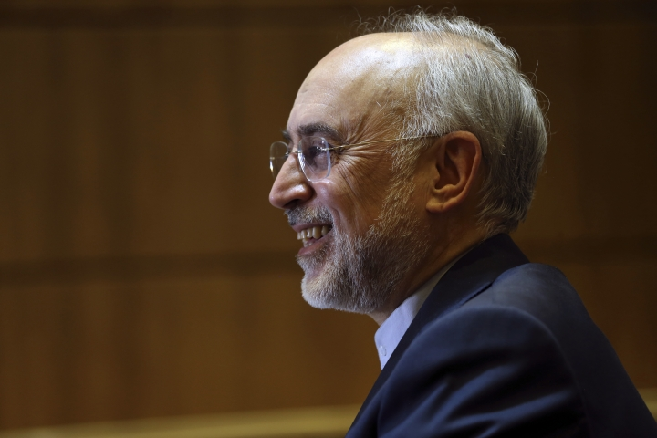 Iran's nuclear chief Ali Akbar Salehi smiles while speaking in an interview with The Associated Press at the headquarters of Iran's atomic energy agency, in Tehran, Iran, Tuesday, Sept. 11, 2018. Salehi told The Associated Press that he hopes the atomic deal between Tehran and world powers survives, but warns the program will be in a stronger position than ever if not. (AP Photo/Vahid Salemi)