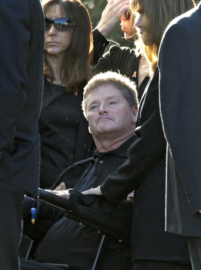 FILE - In this Oct. 22, 2011, file photo, IndyCar team owner Sam Schmidt arrives for the funeral of two-time Indy 500 winning driver Dan Wheldon, in St. Petersburg, Fla. Wheldon was killed driving a Schmidt car in 2011. (AP Photo/Chris O'Meara, File)