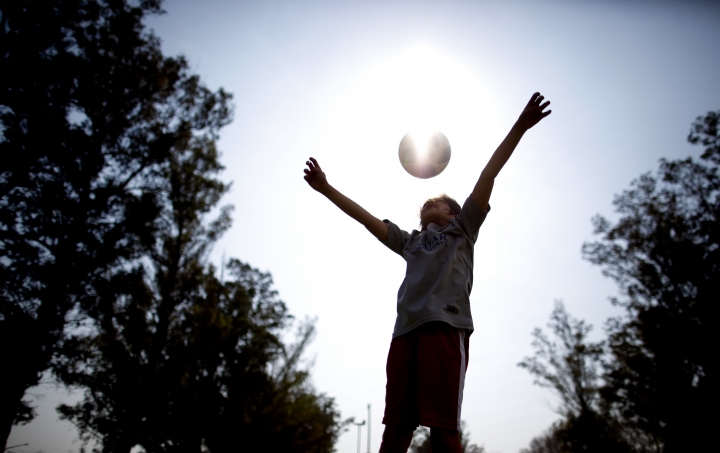 """In this Sept. 8, 2018 photo, Candelaria Cabrera plays with a soccer ball in Chabaz, Argentina. """"Cande,"""" as she is known by friends and family, is the only girl playing in a children's soccer league in the southern part of Argentina's Santa Fe province, birthplace of stars including Lionel Messi, Gabriel Batistuta and Jorge Valdano. (AP Photo/Natacha Pisarenko)"""