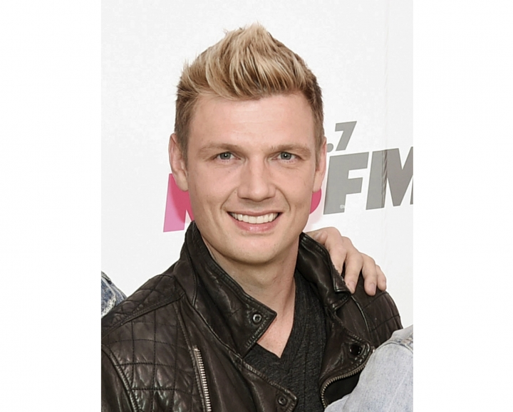FILE - In this May 13, 2017 file photo, Nick Carter of the Backstreet Boys arrives at Wango Tango in Carson, Calif. Prosecutors in Los Angeles have declined to file charges against Carter after a singer reported last year that he had raped her in his apartment in 2003. Prosecutors said Tuesday, Sept. 11, 2018, that because the woman, Melissa Schuman from the group Dream, was 18 at the time, the statute of limitations expired in 2013. They did not evaluate the merits of Schuman's story. (Photo by Richard Shotwell/Invision/AP, File)