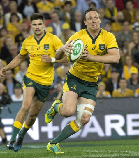 Dane Haylett-Petty of Australia runs the ball against South Africa, during their rugby union test match in Brisbane, Australia, Saturday, Sept. 8, 2018. (AP Photo/Dave Kapernick)