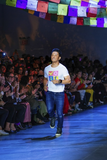 Prabal Gurung jogs onto the runway following his spring 2019 collection during Fashion Week Sunday, Sept. 9, 2018, in New York. (AP Photo/Kevin Hagen).