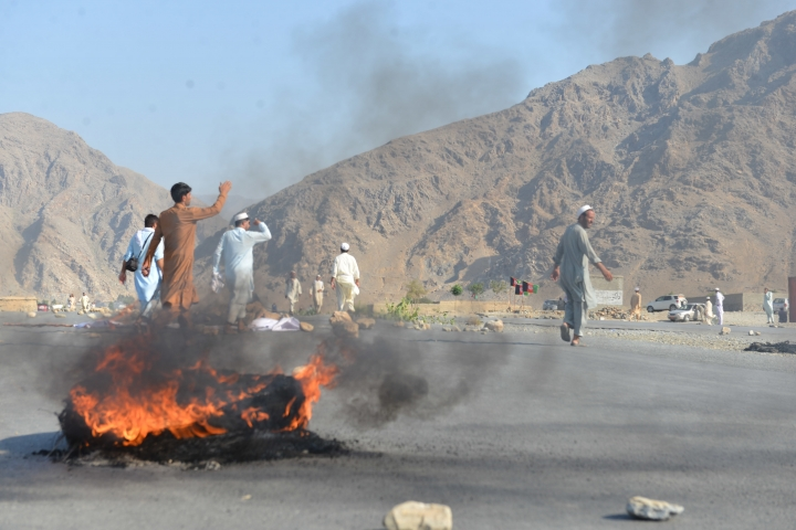 Men shout slogans against terrorists after a suicide attack among the protesters in Momandara district of Nangarhar province, Afghanistan, Tuesday, Sept. 11, 2018. A suicide bomber detonated his explosives-filled vest among a group of people protesting a local police commander in eastern Afghanistan on Tuesday, killing 25 and wounding about 130, a provincial official said. (AP Photo/Mohammad Anwar Danishyar)