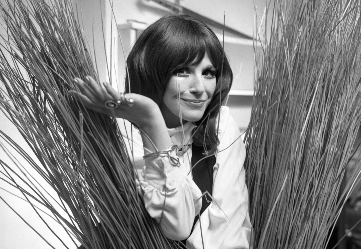 "FILE - In this Sept. 16, 1971, Fenella Fielding poses ahead of a one woman entertainment piece at the Withy Arts Festival in Somerset, England. British actress Fenella Fielding, the glamorous, velvet-voiced star of ""Carry On"" comedies, has died at the age of 90. (PA via AP)"