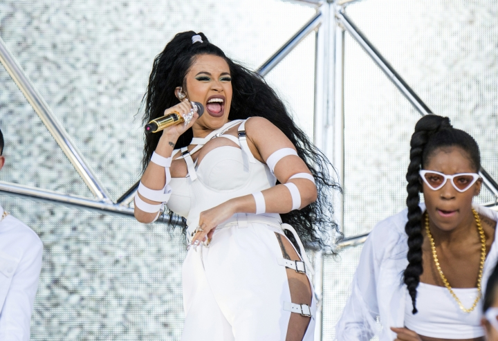 FILE - In this April 22, 2018 file photo, Cardi B performs at the Coachella Music & Arts Festival in Indio, Calif. Rap has easily dominated the pop charts and on streaming services in the last few years, and that's reflected at the 2018 American Music Awards. Drake and Cardi B are the leading nominees with eight each. The AMAs will air live Oct. 9 from the Microsoft Theater in Los Angeles. (Photo by Amy Harris/Invision/AP, File)