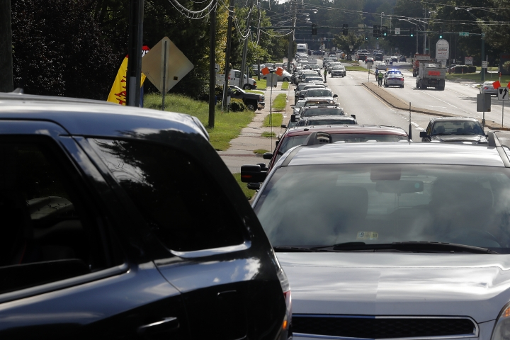 Traffic backs up along Oyster Point Road as people attempt to pickup sandbags Wednesday morning, Sept. 12, 2018. The city of Newport News was offering free sandbags to residents at the Public Works Operations Center as Hurricane Florence approaches. Police officers turned away residents because of traffic congestion on Oyster Point Road. (Jonathon Gruenke/The Daily Press via AP)