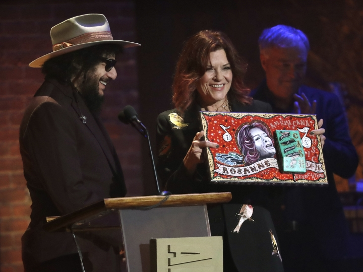 Rosanne Cash accepts the Spirit of Americana Free Speech in Music award during the Americana Honors and Awards show Wednesday, Sept. 12, 2018, in Nashville, Tenn. At left is award presenter Don Was. (AP Photo/Mark Zaleski)