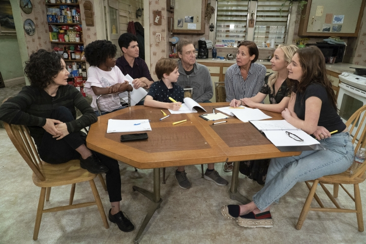 "This image released by ABC shows, from left, Sara Gilbert, Jayden Rey, Michael Fishman, Ames McNamara, John Goodman, Laurie Metcalf, Lecy Goranson and Emma Kenney in a scene from ""The Connors,"" premiering Oct. 16. (Eric McCandless/ABC via AP)"