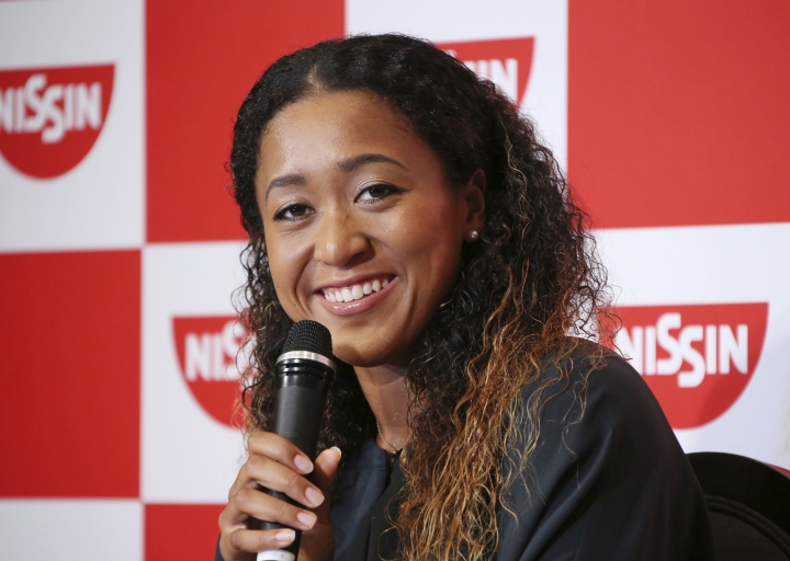 Naomi Osaka, the champion of U.S. Open women's singles, smiles during a press conference in Yokohama , Thursday, Sept. 13, 2018. Osaka defeated Serena Williams of the U.S. on Saturday, Sept. 8, to become the first Grand Slam singles champion from Japan. (AP Photo/Koji Sasahara)