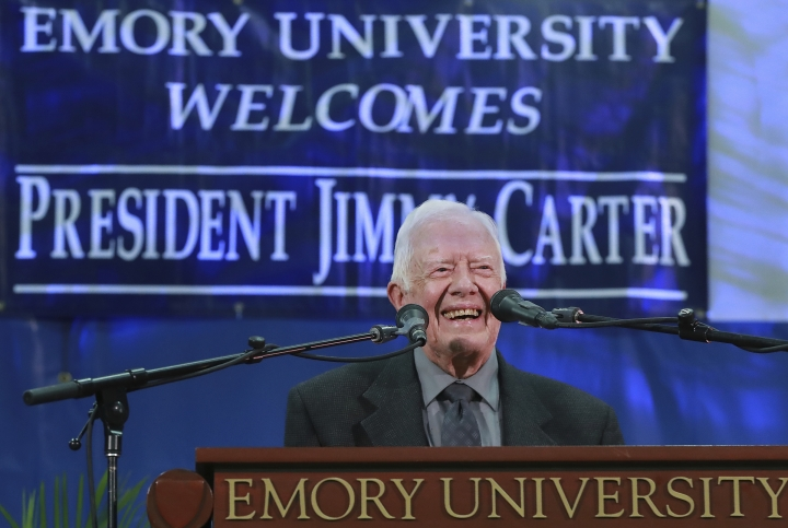 Former President Jimmy Carter takes the podium to answer questions from students during his annual town hall with Emory University freshman in the campus gym on Wednesday, Sept. 12, 2018, in Atlanta. (Curtis Compton/Atlanta Journal-Constitution via AP)