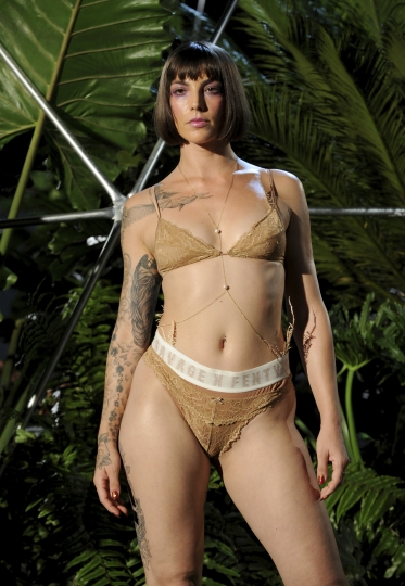 Savage X Fenty fashions are modeled for photographers before a performance at the Brooklyn Navy Yard at the end of Fashion Week, Wednesday Sept. 12, 2018, in the Brooklyn borough of New York.Rihanna unleashed the wild beast in a lush tropical land to debut her second season of Savage x Fenty lingerie and loungewear. (AP Photo/Diane Bondareff)