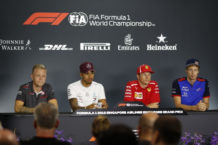 From left to right, Haas Driver Kevin Magnussen of Denmark, Mercedes driver Lewis Hamilton of Britain, Ferrari driver Kimi Raikkonen of Finland and Toro Rosso driver Brendon Hartley of New Zealand listen to questions during a press conference at the Marina Bay City Circuit ahead of the Singapore Formula One Grand Prix in Singapore, Thursday, Sept. 13, 2018. (AP Photo/Yong Teck Lim)