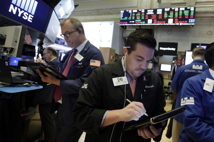 FILE- In this Sept. 6, 2018, file photo Joseph Lawler, right, works with fellow traders on the floor of the New York Stock Exchange. The U.S. stock market opens at 9:30 a.m. EDT on Wednesday, Sept. 12. (AP Photo/Richard Drew, File)
