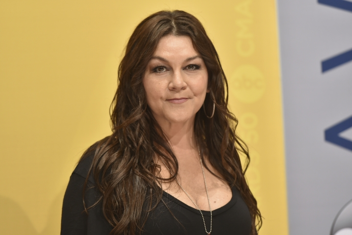 "FILE - In this Nov. 2, 2016 file photo, Gretchen Wilson arrives at the 50th annual CMA Awards at the Bridgestone Arena in Nashville, Tenn. Wilson has agreed to donate $500 to charity to settle a criminal charge related to a disturbance at a Connecticut airport last month. The Grammy-winning ""Redneck Woman"" singer appeared Thursday, Sept. 13, 2018 in court in Enfield. A misdemeanor breach of peace charge will be dismissed based on the donation to a fund for injured crime victims. (Photo by Evan Agostini/Invision/AP, File)"