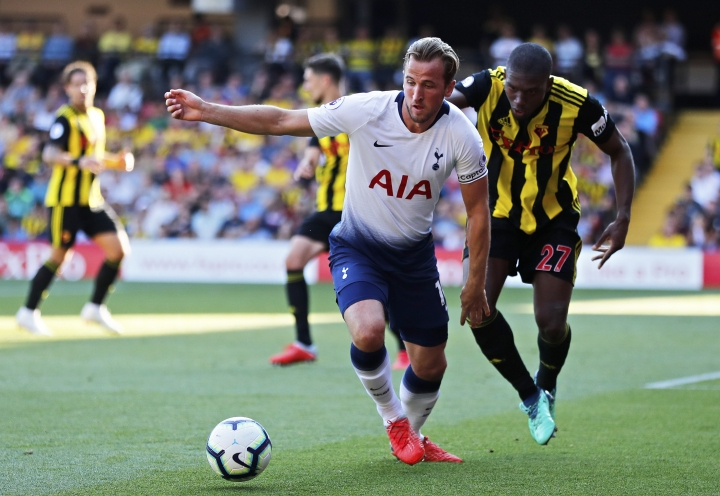 Watford's Christian Kabasele, right, vies for the ball with Tottenham's Harry Kane during the English Premier League soccer match between Watford FC and Tottenham Hotspur at Vicarage Road stadium in Watford, England, Sunday, Sept 2, 2018. (AP Photo/Frank Augstein)