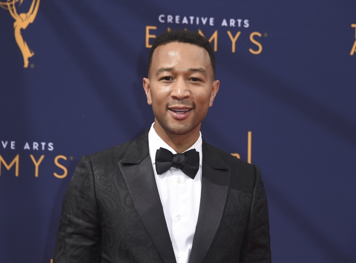 "FILE - In this Sept. 9, 2018 file photo, John Legend arrives at the Creative Arts Emmy Awards in Los Angeles. Legend will become a coach on NBC's ""The Voice."" (Photo by Richard Shotwell/Invision/AP, File)"