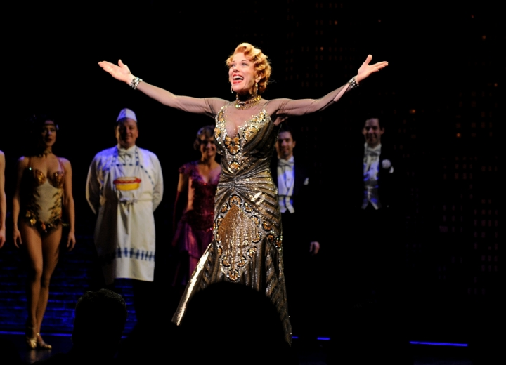"FILE - In this April 10, 2014 file photo, actor Marin Mazzie on stage during the curtain call for the opening night of ""Bullets Over Broadway"" in New York. Mazzie, who battled ovarian cancer starting in 2015, died Thursday, Sept. 13, 2018, at her Manhattan home, said her husband, actor Jason Danieley. She was 57. (Photo by Brad Barket/Invision/AP, File)"